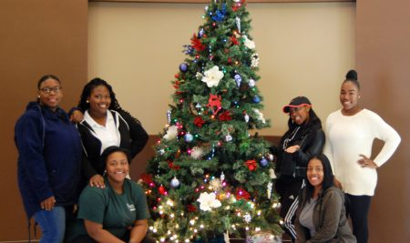 Belles welcome the holiday spirit to Bennett by decorating a Christmas tree in the GLC