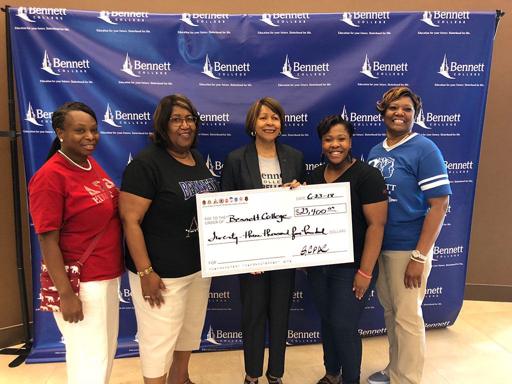 Guilford County Pan-Hellenic Council presents a $23,400 check to Bennett College